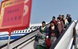 出席十三届全国人大一次会议的京外代表陆续抵京