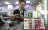 """中国端上金融业开放""""大餐"""" 为跨国公司创造机遇"""