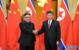 习近平会见朝鲜劳动党委员长金正恩