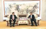 王忠林会见中植企业集团董事局主席解直锟一行