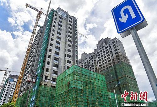 资料图: 图为一在建楼盘 <a target='_blank' href='http://www.chinanews.com/'>中新社</a>记者 骆云飞 摄